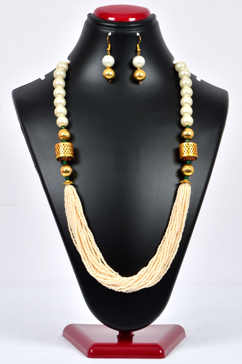 Off White Color Pearl Neckpiece Emblished With Simultated Gold Plated Work And Beads With A Set Of Dangle Earrings - Mcj250117